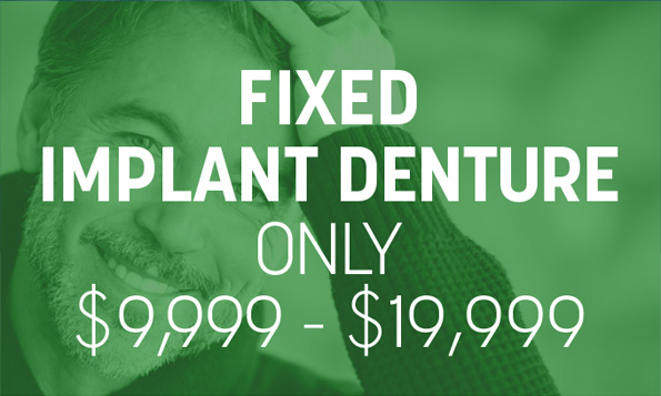 A man grins beneath a special offer for fixed implant dentures at Lovett Dental in Webster, TX