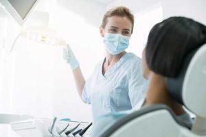 a dentist provides a routine dental exam in texas